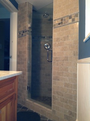 Limestone shower with slate accents